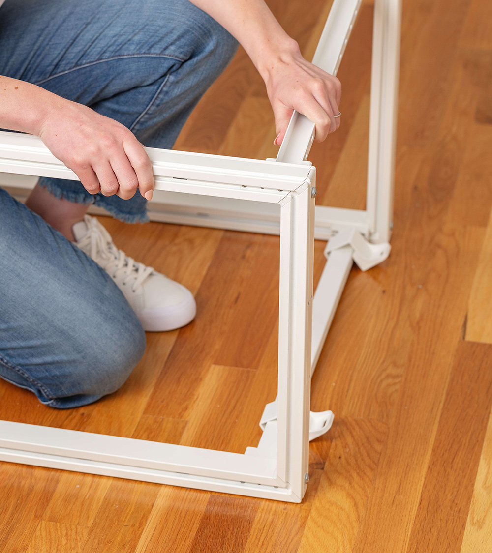 woman putting together frame