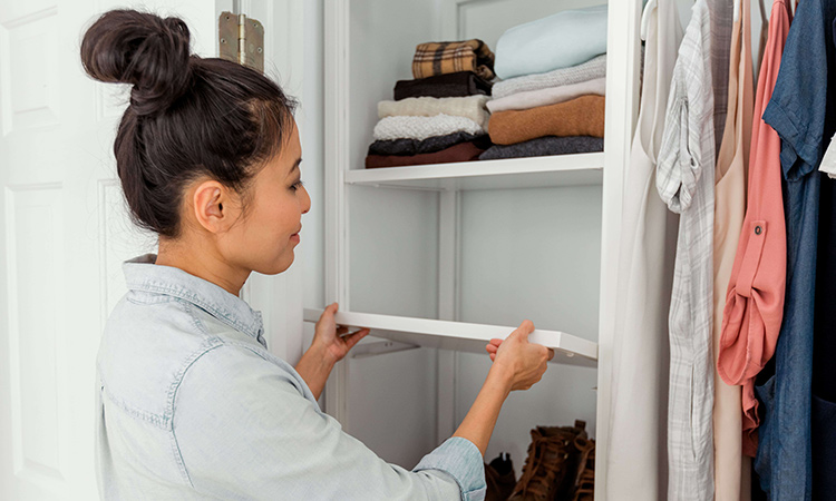 woman adjusting shelf height