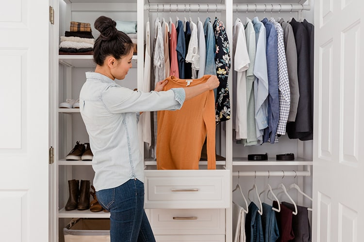 woman opening drawer in closet
