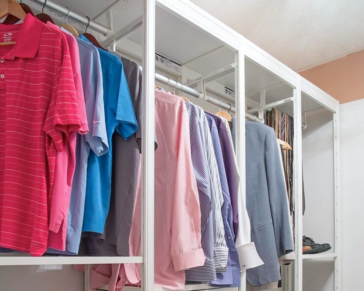 mens shirts hanging in a closet