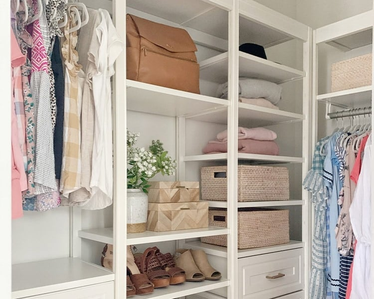 closet with bins and boxes