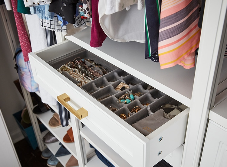 Open closet drawer with jewelry