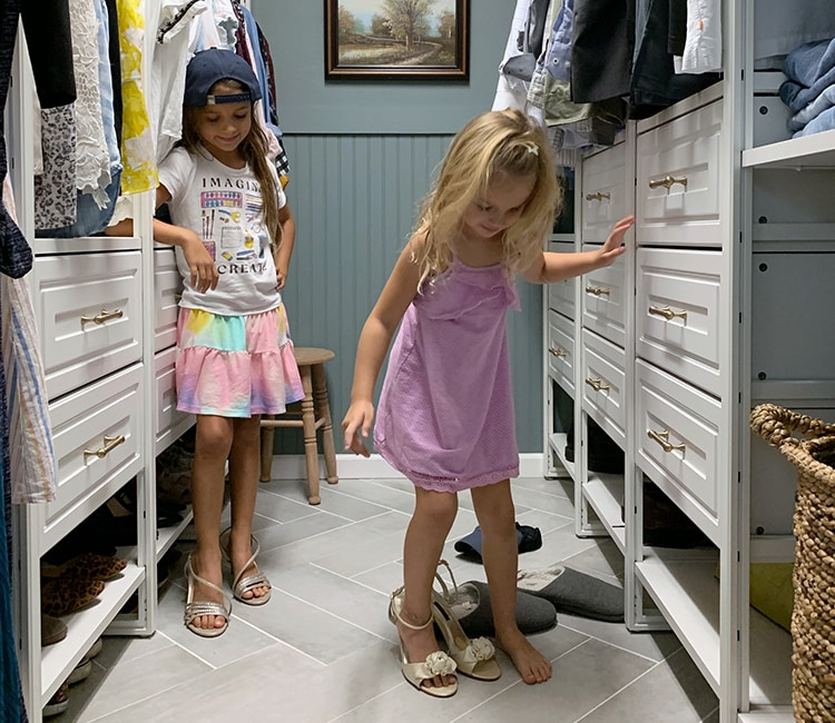 Kids playing dress up in walk-in closet