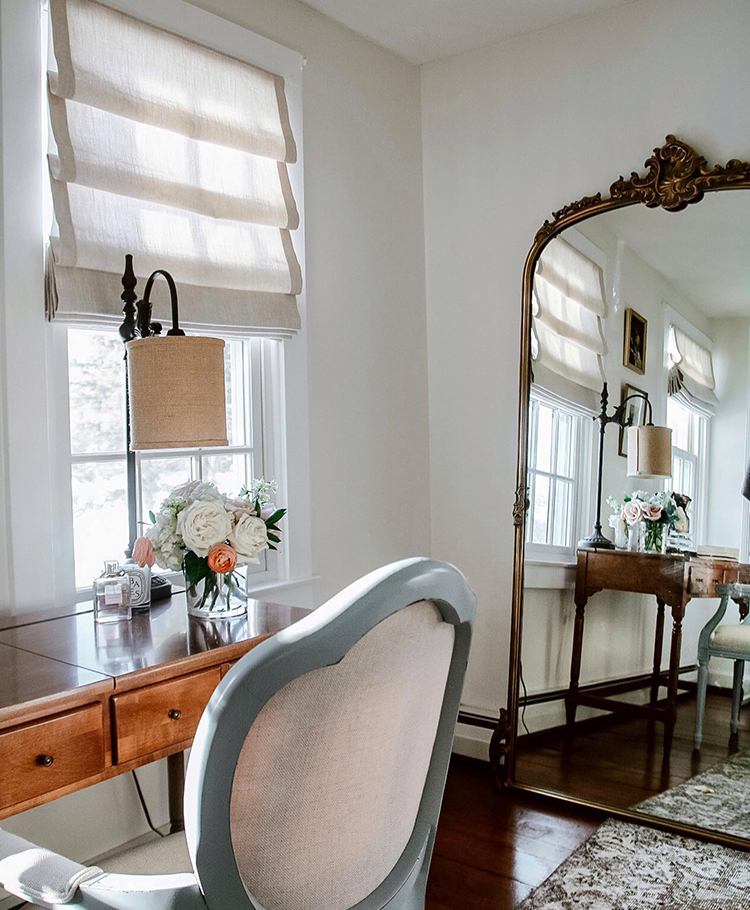 Desk and chair with full length mirror against wall in cloffice