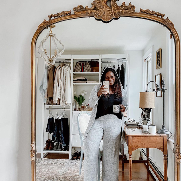 Woman posing in front of mirror showing cloffice setup