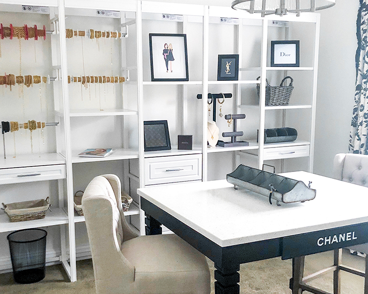 Sewing room with organizer and work table and chair